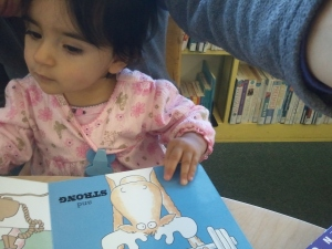 Enjoying a book at the library.