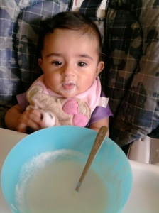 Trying rice cereal at 4 months.
